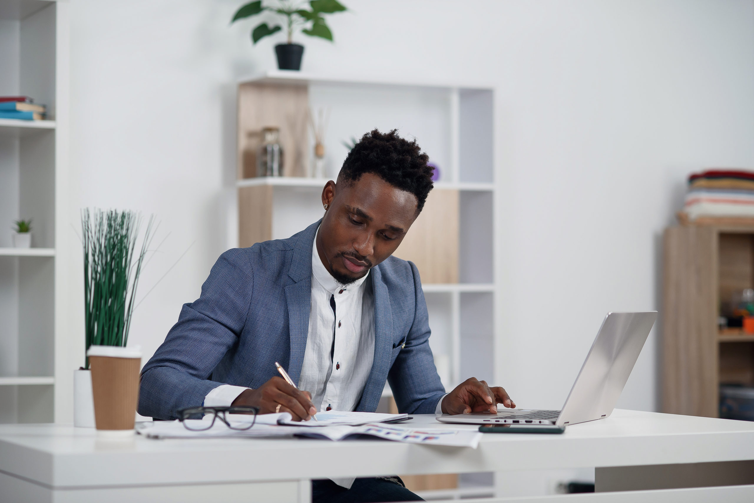 Businessman typing something on laptop in his office.
